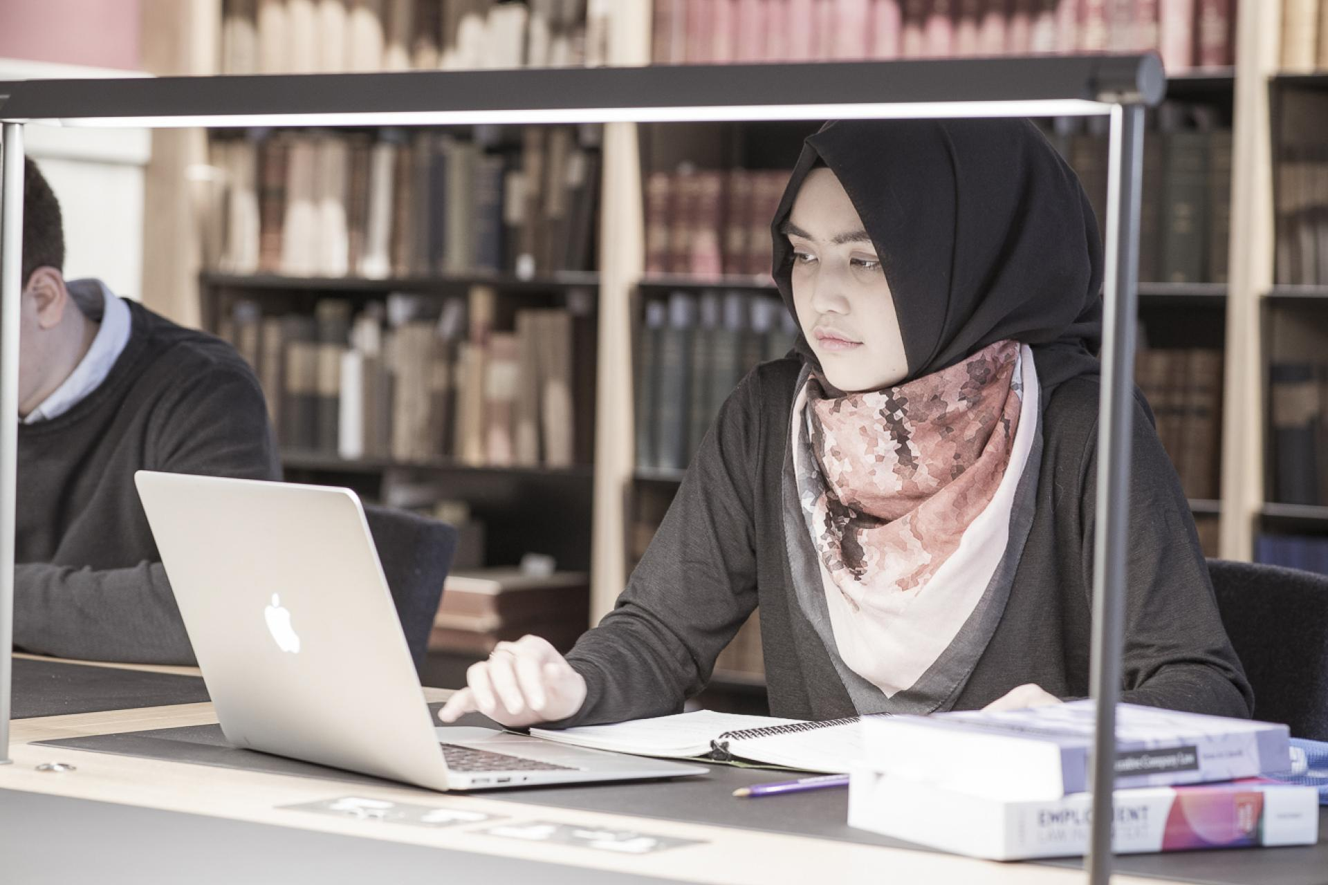 Woman on laptop in library