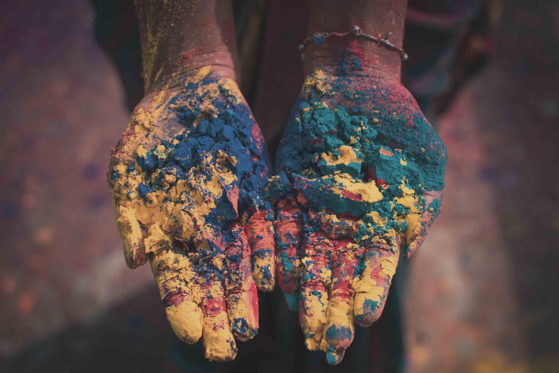 Hands with powdered paint