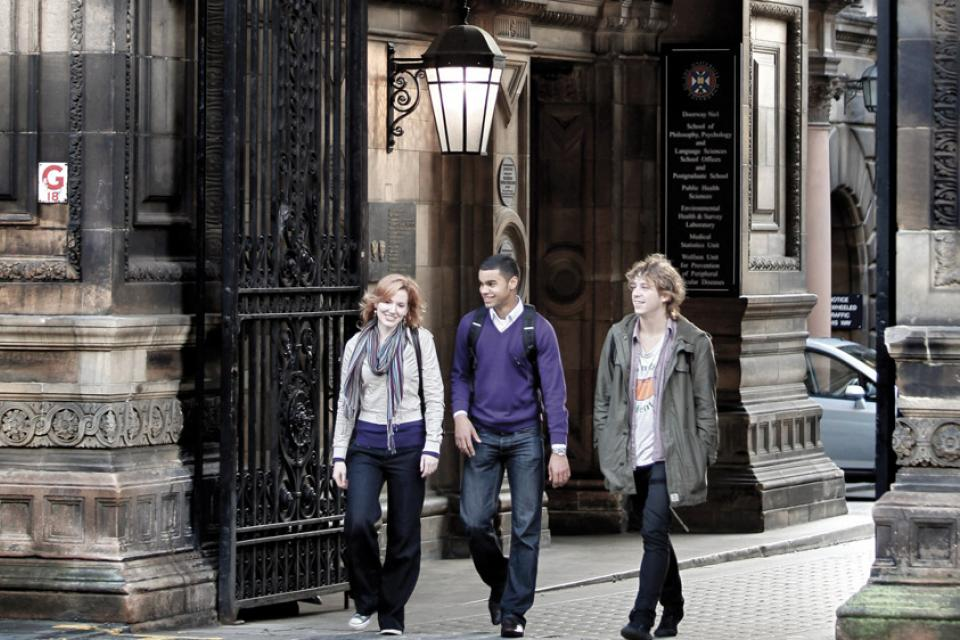 Students walking in the central University of Edinburgh Campus