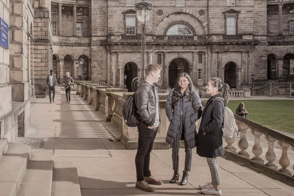 Students talking in the Old College Quad, University of Edinburgh
